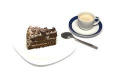 Chocolate cake and mug of a cappuccino with a tea spoon Stock Image