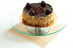 Chocolate cake with nuts isolated Stock Images