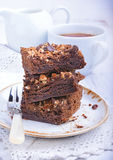 Chocolate cake with nuts. In plate Royalty Free Stock Photography