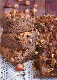 Chocolate cake with nuts. On table Stock Photography