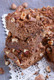 Chocolate cake with nuts. On table Royalty Free Stock Photo