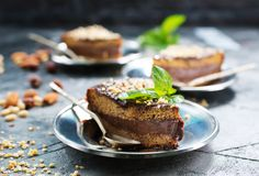 Chocolate cake. With nuts on a table royalty free stock photography