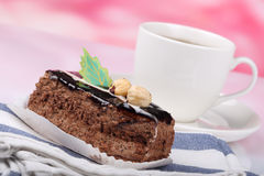 Chocolate cake with nuts and tea Stock Photos