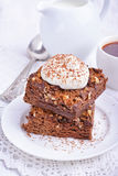 Chocolate cake with nuts and whipped cream Royalty Free Stock Image