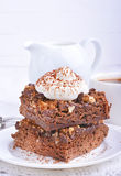 Chocolate cake with nuts and whipped cream Royalty Free Stock Photos
