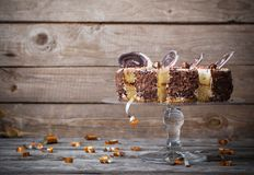 Chocolate cake on old wooden background Royalty Free Stock Photos