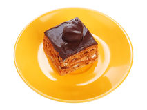 Chocolate cake on orange plate Royalty Free Stock Image