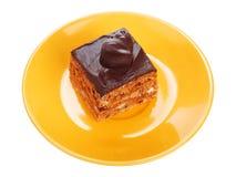 Chocolate cake on orange plate Royalty Free Stock Image
