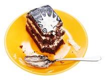 Chocolate cake on orange plate Stock Images