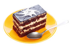 Chocolate cake on orange plate Stock Images