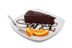 Chocolate cake with orange and topping isolated Stock Image