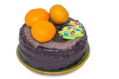 Chocolate cake and oranges on a ceramic dish on white background Stock Photo