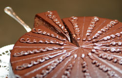 Chocolate cake, parts. Tasty round chocolate cake with interesting design on top Stock Photos