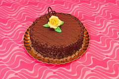 Chocolate cake on pink background Royalty Free Stock Images