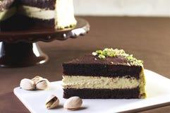 Chocolate cake with pistachio. Cream Royalty Free Stock Photography