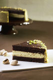 Chocolate cake with pistachio. Cream Royalty Free Stock Images