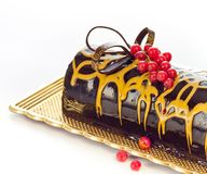 Chocolate cake on a plate. Stock Photos