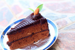 A chocolate cake on a plate. A chocolate cake on a plate Royalty Free Stock Photography