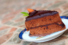 A chocolate cake on a plate. A chocolate cake on a plate Royalty Free Stock Image