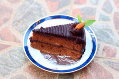 A chocolate cake on a plate. A chocolate cake on a plate Stock Image