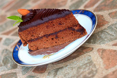 A chocolate cake on a plate. A chocolate cake on a plate Stock Images