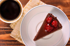 Chocolate cake in plate with black coffee Royalty Free Stock Photography