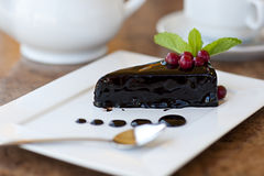 Chocolate cake on a plate. Dessert Royalty Free Stock Image