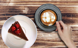 Chocolate cake in plate with late coffee. Chocolate cake in white plate with late coffee royalty free stock photos