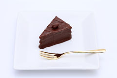 Chocolate cake. On plate on white background Stock Photo