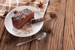 Chocolate cake on a plate on a wooden boards background Royalty Free Stock Photography