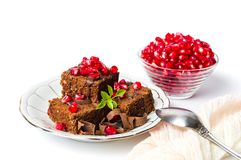 Chocolate cake with pomegranate on a plate Royalty Free Stock Photography