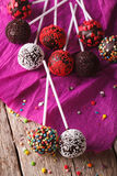 Chocolate cake pops with candy sprinkles closeup on an table. ve Stock Photo