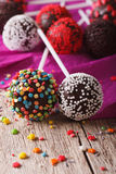 Chocolate cake pops with candy sprinkles macro on an table. vert Royalty Free Stock Photos