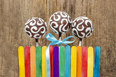 Chocolate cake pops and colorful rainbow fence Royalty Free Stock Photo