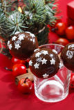 Chocolate cake pops decorated with sugar stars Stock Image