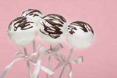 Chocolate cake pops on pink background Stock Images