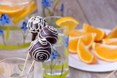 Chocolate Cake pops on the sticks in glass, wooden Royalty Free Stock Photography