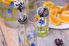 Chocolate Cake pops on the sticks in glass, wooden Stock Images