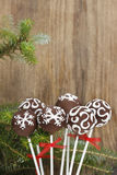 Chocolate cake pops on wooden background Royalty Free Stock Image