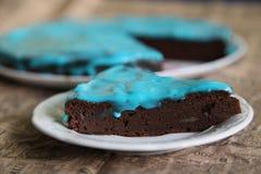 Chocolate cake. Pumpkin cake with blue cream Stock Photos