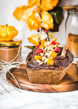 Chocolate cake with pumpkin, nuts and frosting, autumn baked,sel Royalty Free Stock Photos