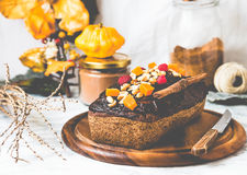 Chocolate cake with pumpkin, nuts and frosting, autumn baked,tin Royalty Free Stock Images