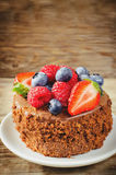 Chocolate cake with raspberries, blueberries and strawberries Stock Images