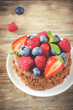 Chocolate cake with raspberries, blueberries and strawberries Royalty Free Stock Photos