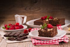 Chocolate cake. Chocolate cake with raspberries on white dish royalty free stock photos