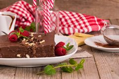 Chocolate cake. Chocolate cake with raspberries on white dish stock image