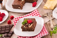 Chocolate cake. Chocolate cake with raspberries on white dish stock images