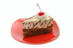 Chocolate cake on red dish Royalty Free Stock Images