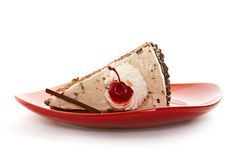 Chocolate cake on red dish Stock Photos
