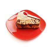 Chocolate cake on red dish Royalty Free Stock Photos